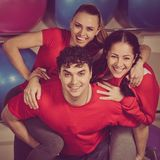 Team of fitness trainers. Portrait of young happy laughing team of fitness trainers stock image