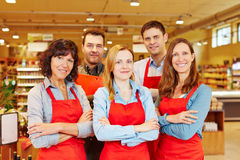 Team of five salespeople in supermarket Royalty Free Stock Photography