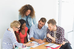 Team of focused young designers having a meeting Royalty Free Stock Image