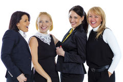 A team of four business women on a white background. Business wo Stock Images