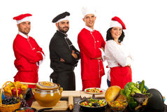 Team of four chefs. Standing with arms folded isolated on white background Royalty Free Stock Photo