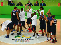 Team France celebrates victory after group A basketball match of the Rio 2016 Olympic Games against team Serbia Stock Photo