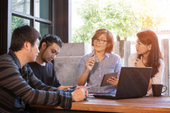 Team of freelance meeting for working solution in home office Royalty Free Stock Image
