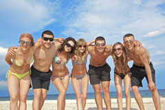 Team of friends at the beach Royalty Free Stock Images