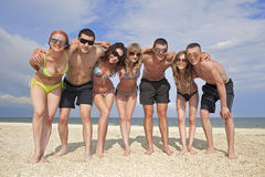 Team of friends at the beach Royalty Free Stock Photo