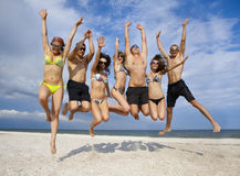 Team of friends jumping at the beach Royalty Free Stock Images