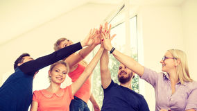 Team of friends showing unity with their hands together Stock Images