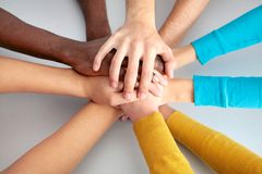 Team of friends showing unity with their hands together Stock Photos