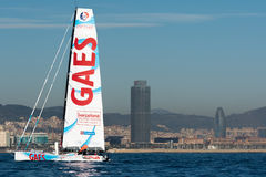 Team Gaes. Boat and Barcelona City Background. Barcelona World Race Royalty Free Stock Image