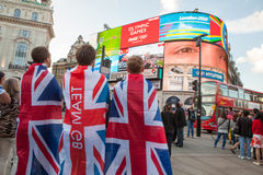 Team GB Supporters at Piccadilly Circus. This picture show 3 team gb supporters watching the london 2012 games on the big screen at piccadilly circus Stock Images