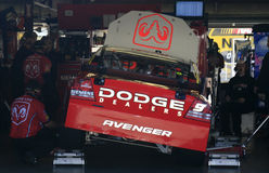 The team gets busy on the #9. Kasey Kahne's team tweaks the #9 Dodge Car of Tomorrow in the garage area before heading out onto the track at New Hampshire Royalty Free Stock Photos
