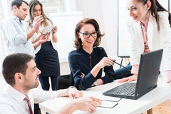 Team giving business report to boss in office stock photos