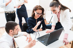 Team giving business report to boss in office Royalty Free Stock Photography