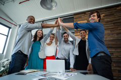 Team of graphic designers giving high five to each other. In office Royalty Free Stock Images