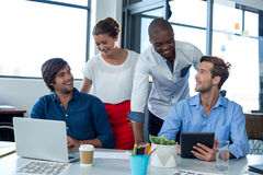 Team of graphic designers interacting with each other. In office Royalty Free Stock Photography