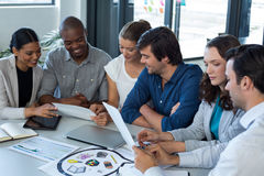 Team of graphic designers interacting with each other. In office Stock Photo