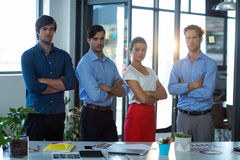 Team of graphic designers standing with arms crossed stock photos