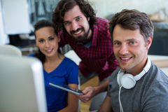 Team of graphic designers working at desk Stock Photography