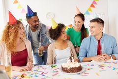 Team greeting colleague at office birthday party Stock Images