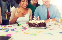 Team greeting coworker at office birthday party stock photo