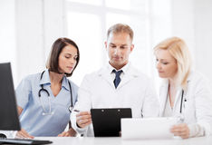 Team or group of doctors on meeting Stock Photos
