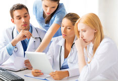 Team or group of doctors working. Picture of young team or group of doctors working stock photo