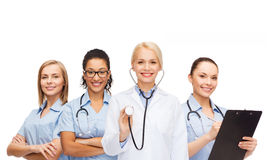 Team or group of female doctors and nurses. Medicine and healthcare concept - team or group of female doctors and nurses Royalty Free Stock Images