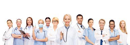 Team or group of female doctors and nurses. Medicine and healthcare concept - team or group of female doctors and nurses Stock Image