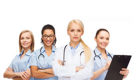 Team or group of female doctors and nurses. Medicine and healthcare concept - team or group of female doctors and nurses Stock Photos