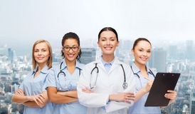 Team or group of female doctors and nurses. Medicine and healthcare concept - team or group of female doctors and nurses Royalty Free Stock Photo