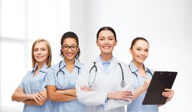 Team or group of female doctors and nurses. Medicine and healthcare concept - team or group of female doctors and nurses Royalty Free Stock Image