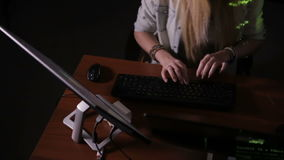 Team of hackers, hacking computers, working in dark room. HD stock video