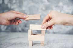 Team hand wooden cubes on table stock photography