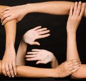 Team hand work. Over dark background Royalty Free Stock Photography