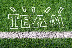 TEAM hand writing text on soccer field grass Royalty Free Stock Photography