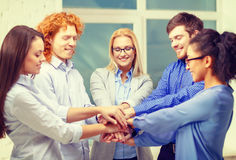 Team with hands on top of each other in office Royalty Free Stock Photo