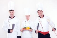 Team of happy chefs. Three happy chefs on the white background Stock Images