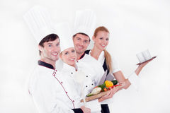 Team of happy chefs. Nice young chefs isolated on white Royalty Free Stock Photography