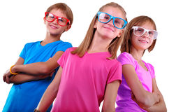Team of happy children wearing eyeglasses isolated over white. Childhood, happiness, friendship concept Royalty Free Stock Photo