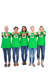 Team of happy female environmental activists giving thumbs up Royalty Free Stock Images