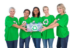 Team of happy female environmental activists holding box of recy Stock Photos