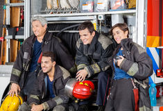 Team Of Happy Firefighters By Firetruck Stock Image