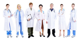 Team of happy laughing doctors. Standing in line - white background Stock Images
