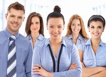 Team of happy office workers. Team portrait of happy office workers wearing uniform, looking at camera smiling royalty free stock image