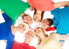 Team of happy young people in Christmas hats celebrating Christmas or New Year. Stock Image