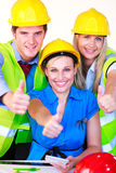 Team with hard hats looking at the camera Royalty Free Stock Photos