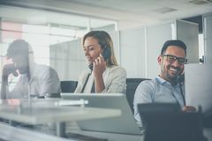 We are the team that is here for you. People in operations center talking on Landline phone stock images