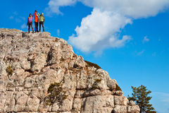 Team of hikers on the rocky summit stock photography