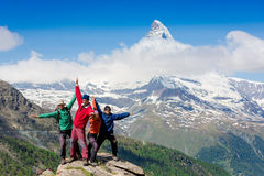 Team of hikers on the rocky summit royalty free stock images