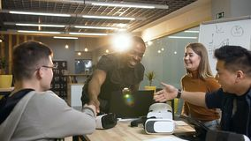Team of hipster people greeting each other and sitting at the table. Team of hipster people greeting each other and sitting at the table and start business stock footage